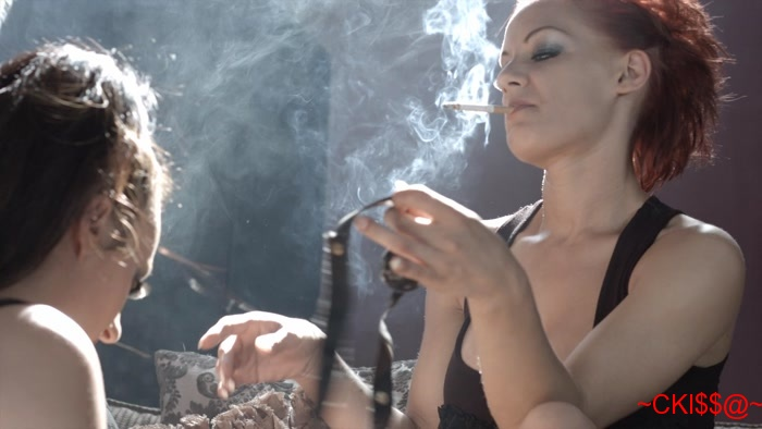 image Mistress loulou dominates her slave with her smoke