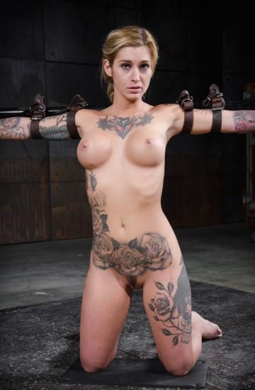 Toned and tattooed Kleio Valentien belt bound
