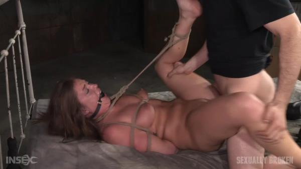 Maddy O'Reilly - Redheaded Maddy O'Reilly is ball gagged, tightly tied and ragdoll fucked by two big