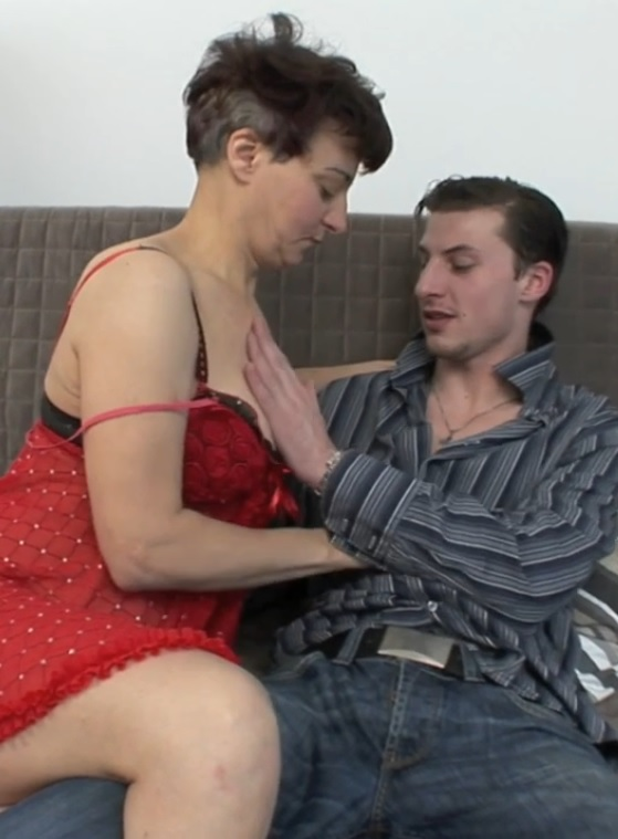 Short-haired elderly woman has sex with a young guy
