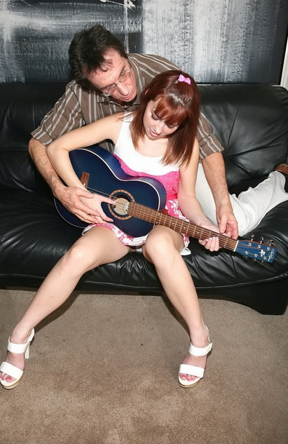 Teach her to play guitar