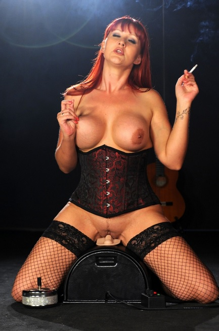 Amber Leigh smoking on the sybian sex machine
