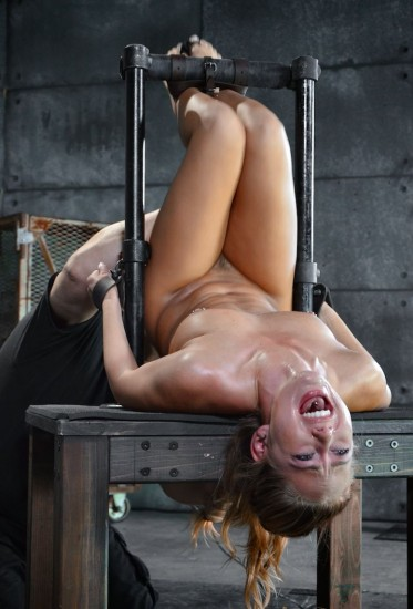 Wholesome blonde Carter Cruise restrained in device bondage