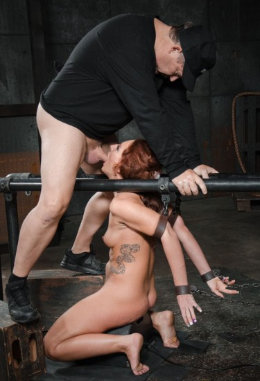 Redhead Savannah Fox chained to a sybian